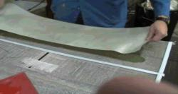 Peel Ply is positioned over the laminated part